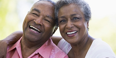 couple-afro-dental-implant